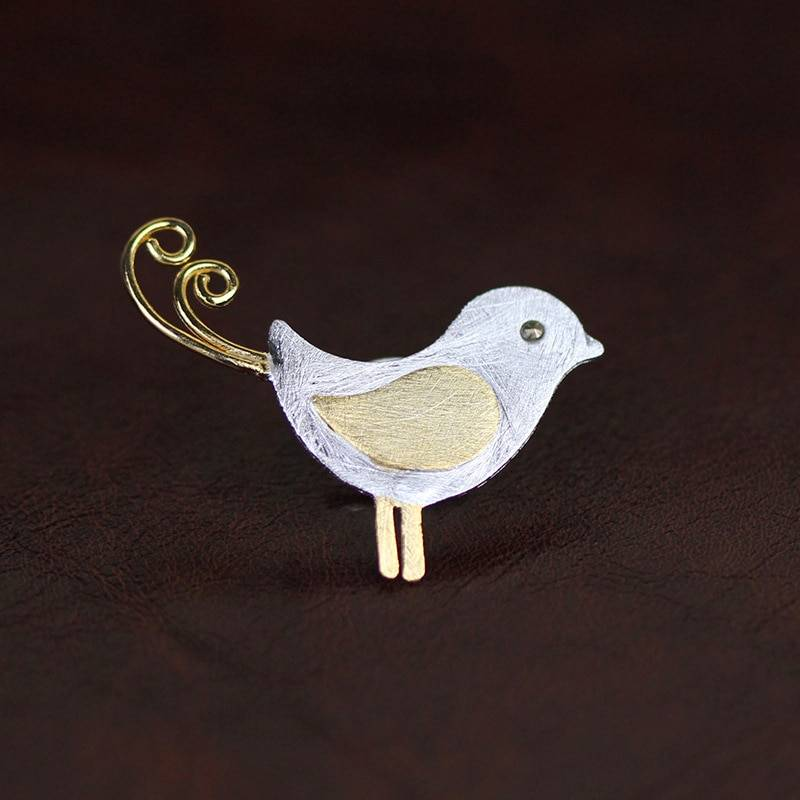 Silber-Pin, Kleiner Vogel mit Ringelschwanz, gebürstet und teil-vergoldet | 925 Brosche 925 Silber Broschen